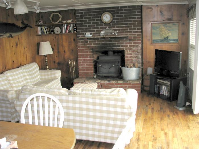 Gull's Call living room nautical theme wood stove